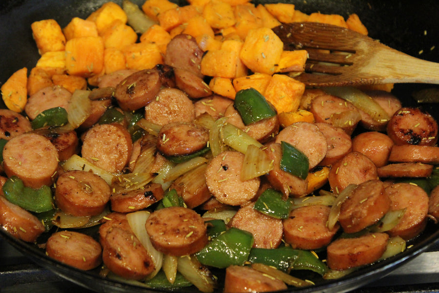 Turkey sausage with bell peppers, onions, and roasted sweet potatoes