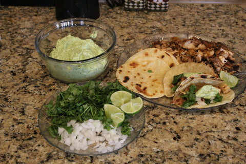 Healthy Low Fat Chipotle Lime Chicken Tacos topped with Creamy Guacamole Sauce and Cilantro and Onions