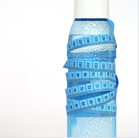 Cold water bottle with measuring tape around it. Gym Devotion blog article. Ways to speed up your metabolism.