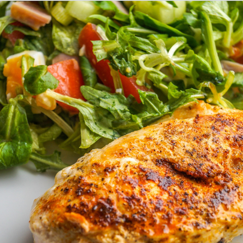 Grilled chicken with salad greens. Ways to speed up metabolism blog article image by Gym Devotion
