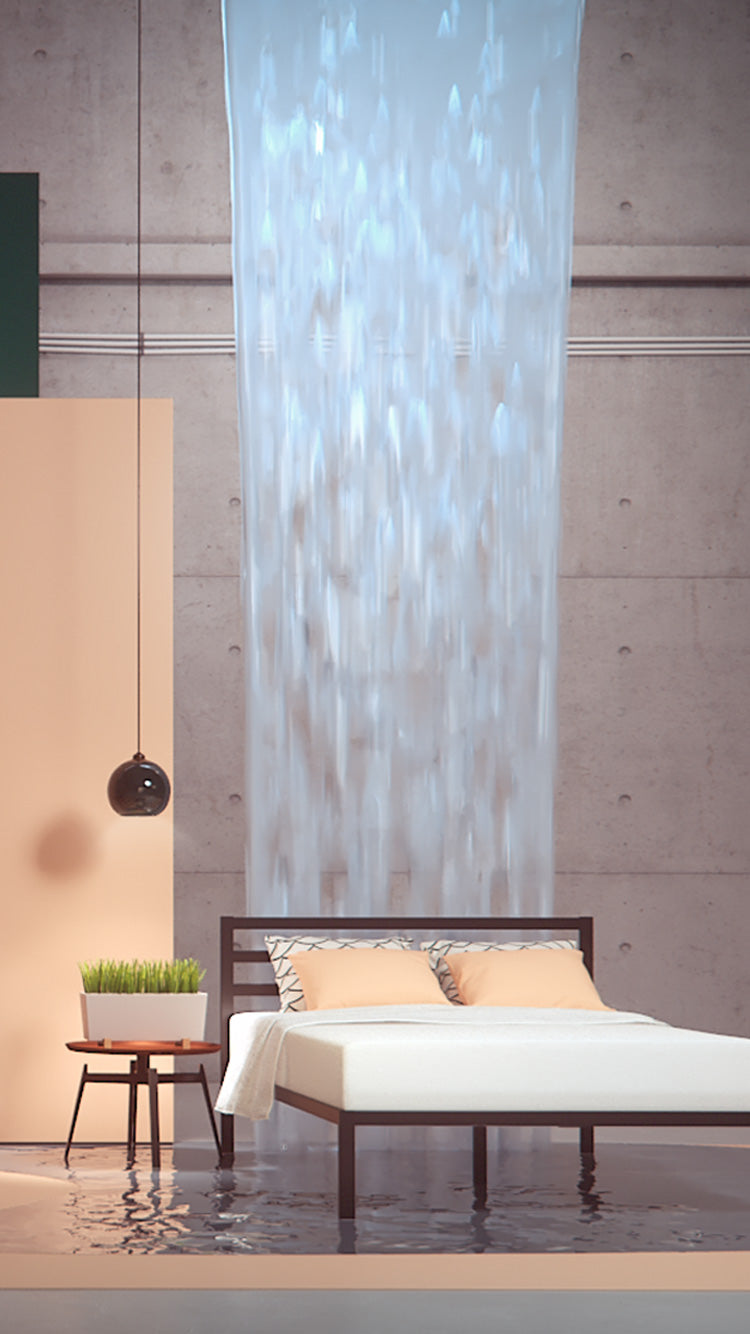 Image of a bed centered on a mattress scene with a waterfall behind it.