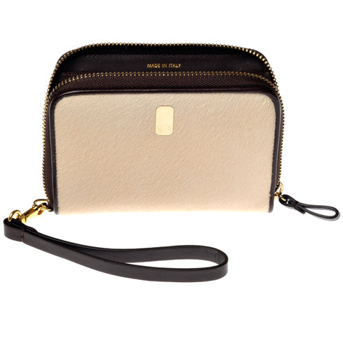 The Güs Clutch is a combined purse and wallet for women looking for something special and not wanting to carry too much. It's a sexy piece with a detachable leather wrist strap. Available in Latte and Mocha Pony Hair suede with 24K gold trim. Front view.