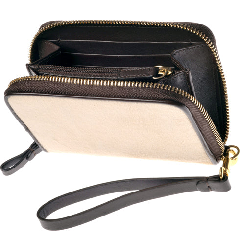 The Güs Clutch is a combined purse and wallet for women looking for something special and not wanting to carry too much. It's a sexy piece with a detachable leather wrist strap. Available in Latte and Mocha Pony Hair suede with 24K gold trim. Rear view.