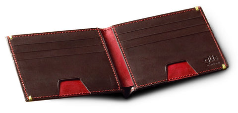 The Güs Men's Horizontal Billfold in vegetable-tanned saddle leather. Interior image of brown with chili-pepper red calfskin lining.