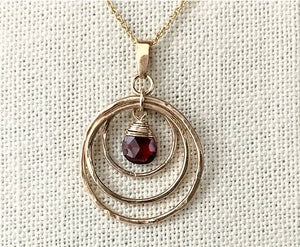 Dogwood Orbit Rings Necklace with Garnet