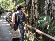 Wondering in Laos with handwoven junglevine eco crossbody bag