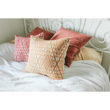 handwoven pillows from Laos on a bed for design