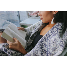 cozy reading in a handwoven blanket scarf from Laos