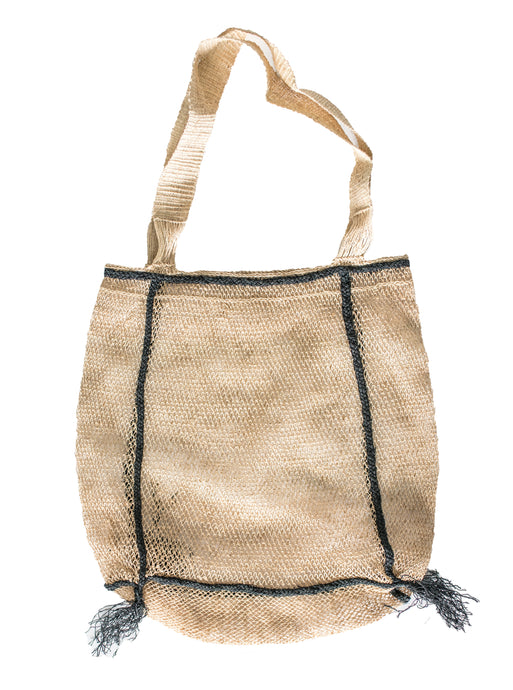 all natural junglevine bag with beautiful black tassel detail at bottom