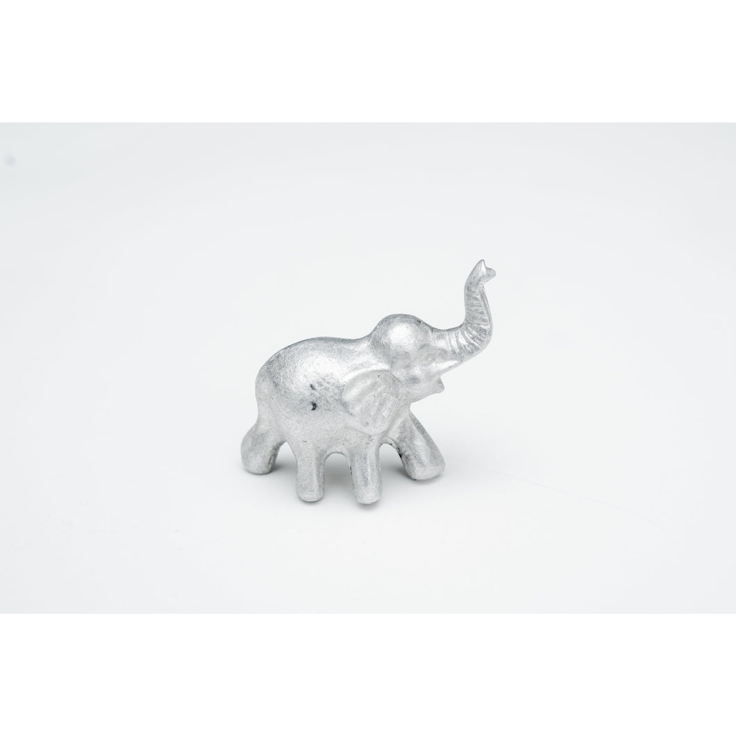 mini lucky elephant figurine with truck up made from bombs, meaningful gifts that support elephant conservation