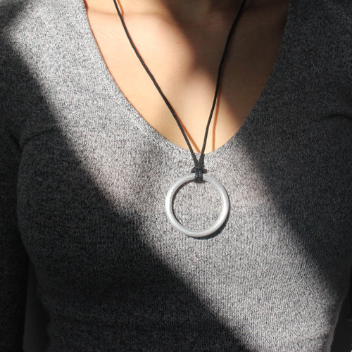 circle shaped necklace upcycled from bombs  dropped in Laos