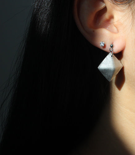 diamond earrings upcycled from bombs dropped in Laos