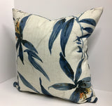 Indigo Tropical Leaf Decorative Pillow Cover on a Herringbone Linen Background
