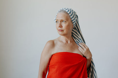Woman wearing the Waffle Weave and Stripe Turkish Towels