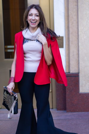 Woman wearing the KISA Cape Blazer in Red