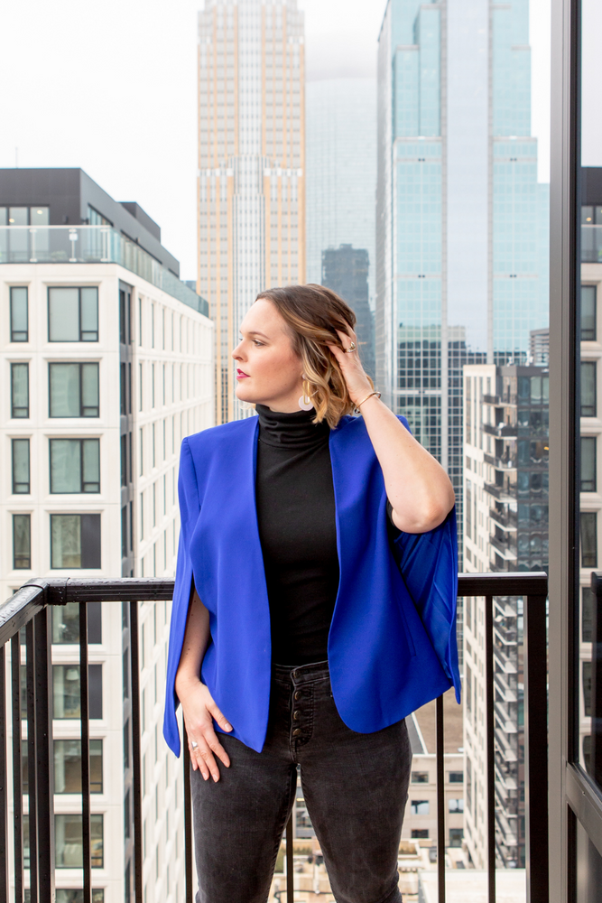 Woman wearing the KISA Cape Blazer in Royal Blue