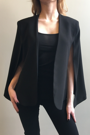 Woman wearing the KISA Cape Blazer in Black