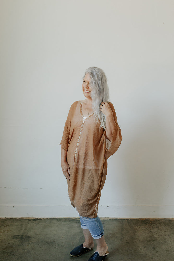 Woman wearing the KISA Tunic Dress in Camel along with KISA Slip On Mules
