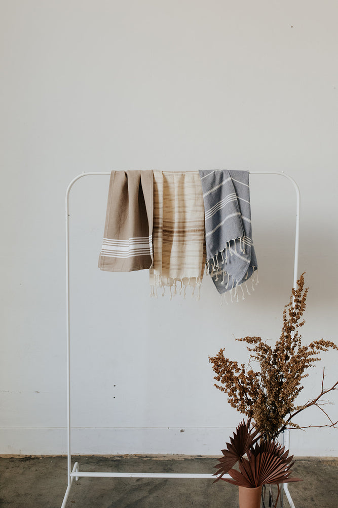 3 KISA Hand Towels in neutral colors: White Stripe, Ribbon, and Multi Stripe