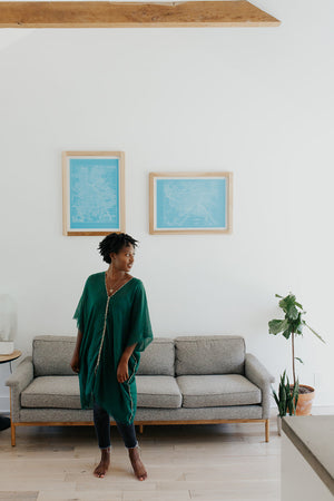 Woman wearing the KISA Tunic Dress in Emerald