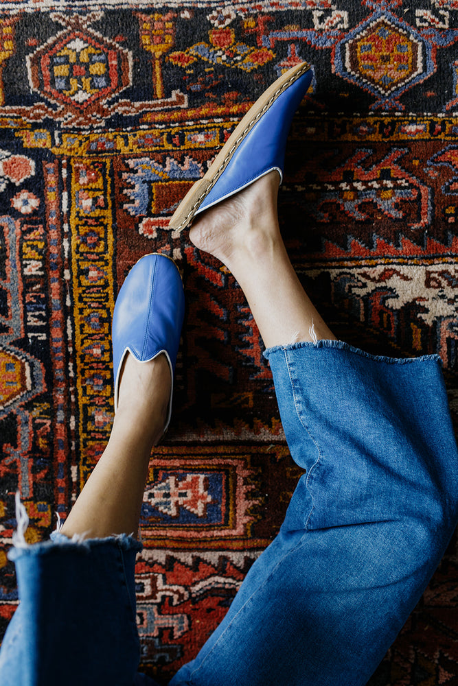 Blue Leather Mules with Trim paired with cut-off blue jeans