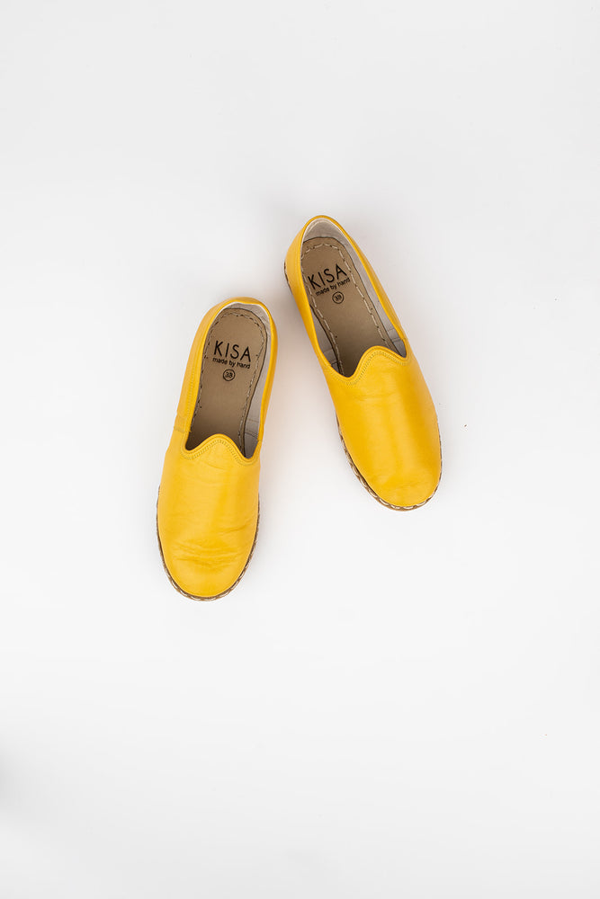 Bold Leather Slip On Shoes in Yellow
