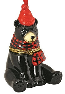 black bear ornament wearing a red hat and black and red plaid scarf