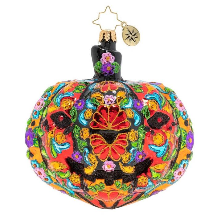 pumpkin shaped hanging ornament very busy colorful orange red with blue accents
