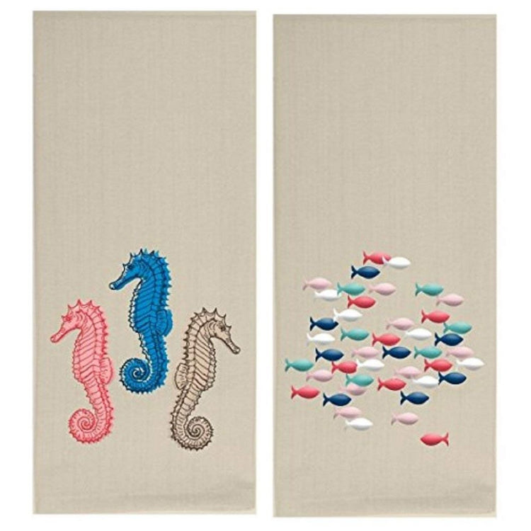 2 tan towels. 1 has 3 embroidered seahorses, pink, blue & brown. 1 has embroidered fish, shades of pink, blue & white.