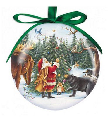 Round ball ornament with green ribbon. Santa is seen decorating tree with moose, fox, bear, squirrel and bird.