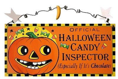 "Orange wood sign. Jack-o-lantern on left. text on right ""Official Halloween Candy Inspector (especially if it's chocolate)"""