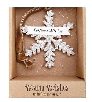 "White snowflake shaped ornament with brown ribbon hanger in brown box with text ""Warm Wishes Mini Ornament"""