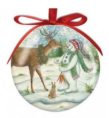 Round ball ornament with red ribbon shows deer, snowman & rabbit.