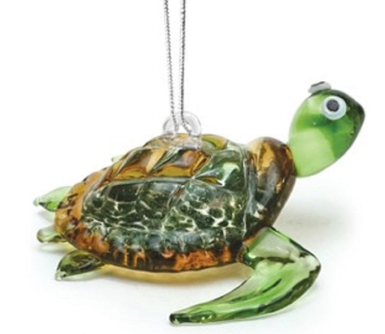 clear green glass sea turtle ornament with brown & gold shell. Turtle in swimming position. Silver hanger connects to back.