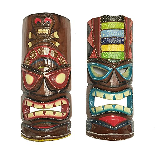 2 wood carved and painted tiki masks. One is mostly red and black, the other is mostly blues and greens.
