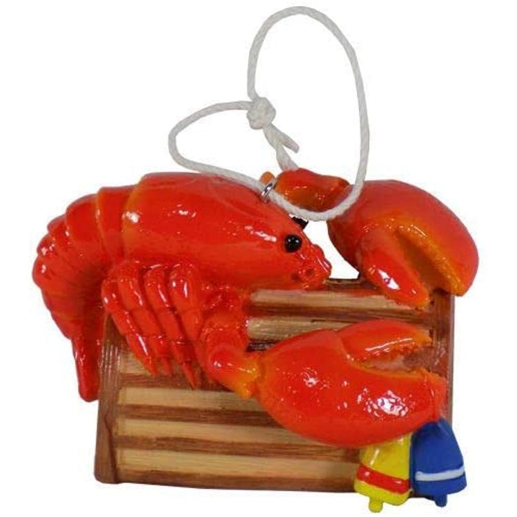 Hanging ornaments shaped like a red lobster on a brown lobster trap.