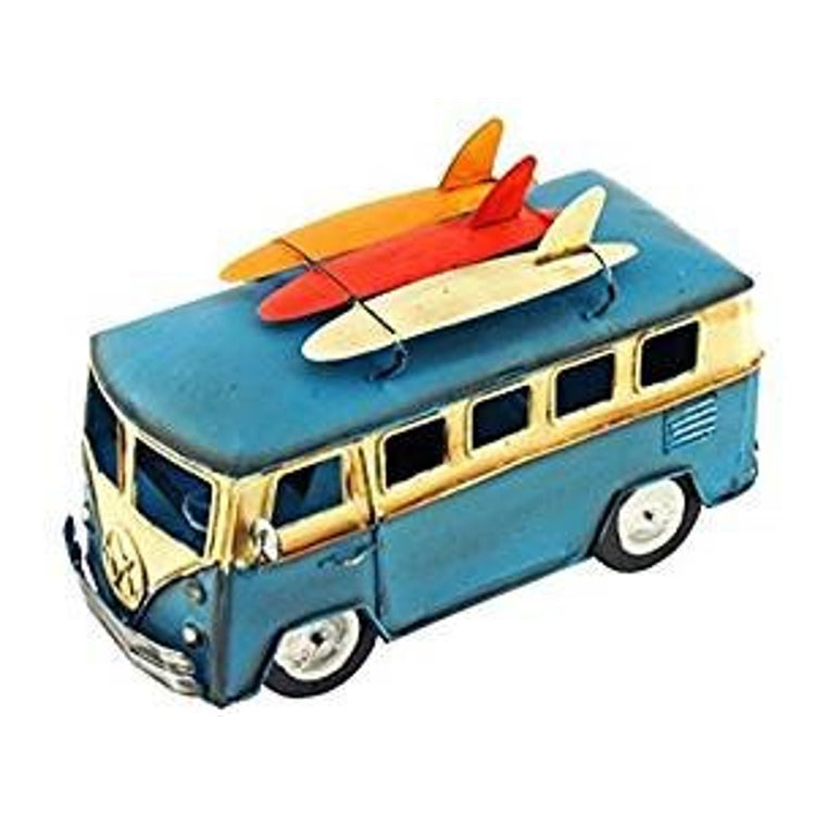 Metal blue VW van with a white stripe and 3 surfboards on top.
