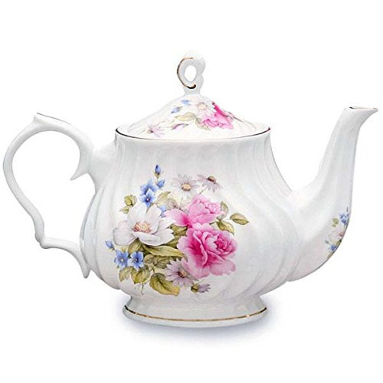 Ribbed white tea pot. Pink, white & blue flowers on front, lid & spout. All edges are trimmed gold. Loop handle on lid.