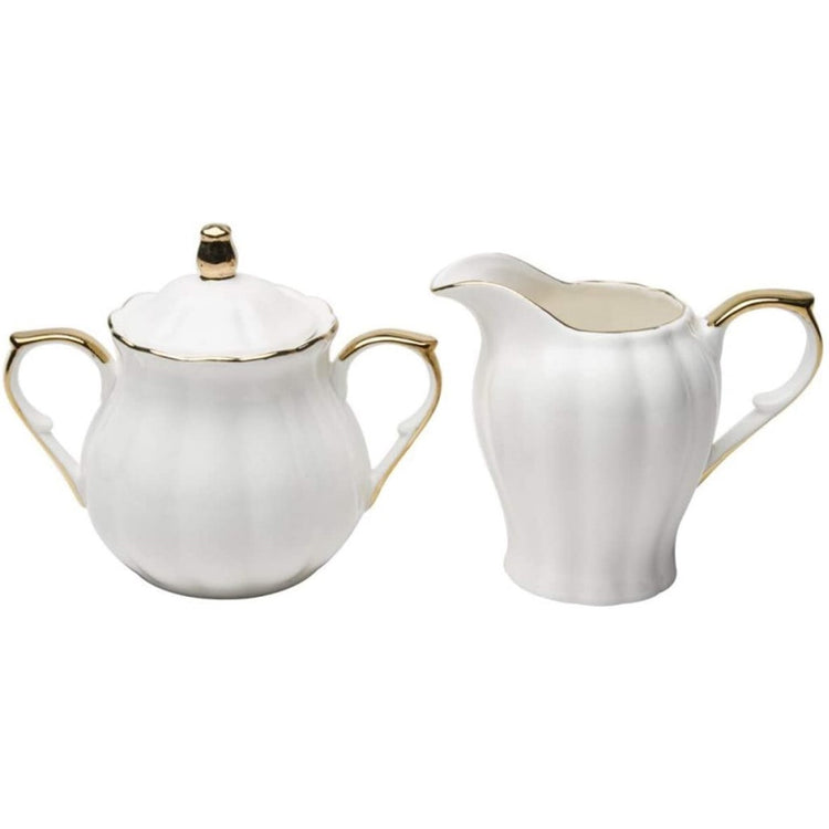 White scalloped cream & sugar set with gold handles & trim.