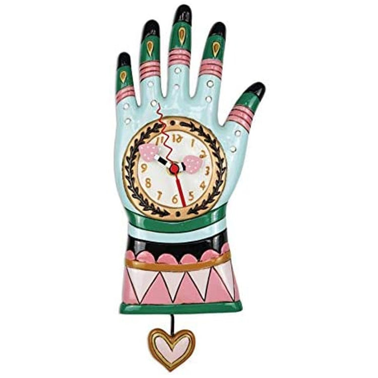 Blue, pink, green & black hand with pink heart pendulum.