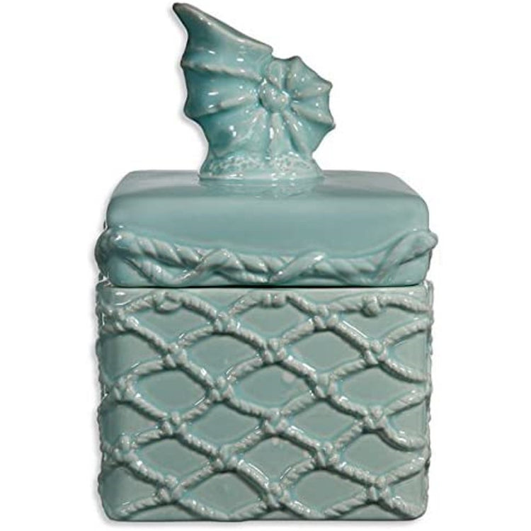 Teal box with a nautilus shell on the lid.