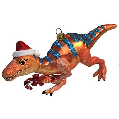 Orange dinosaur with blue stripes, Santa hat, holding a candy cane . Embellished with glitter.