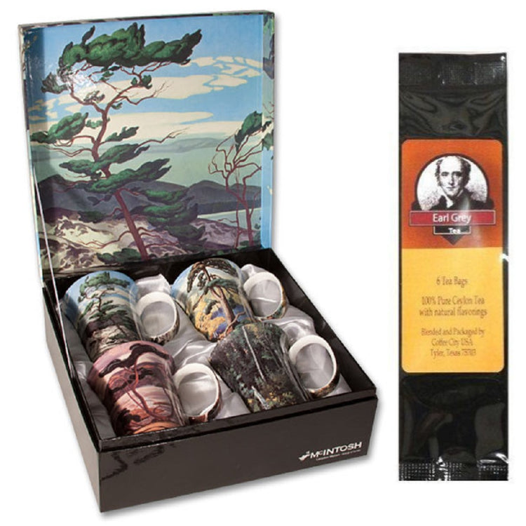 4 mugs in a gift box & a black package of tea bags. The mugs show art from famous Canadian artists.