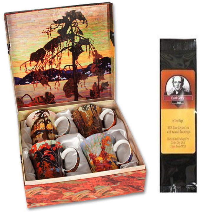 4 mugs, a gift box & a black package of tea bags. The box and the mugs all show artwork from Tom Thompson.