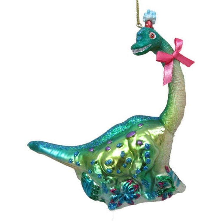 Teal & green long neck dinosaur with blue & purple polka dots and a pink bow on its neck.
