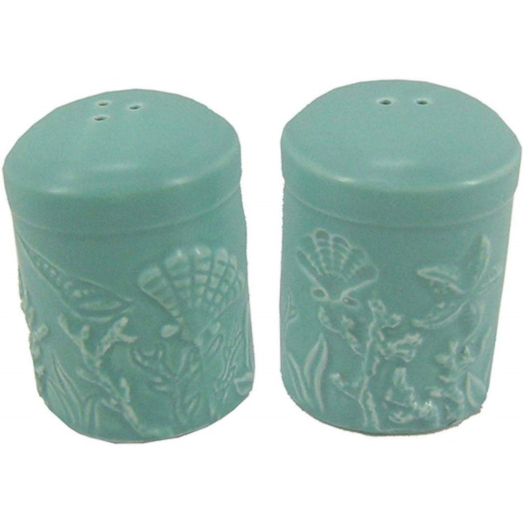 Pair of teal shakers with embossed sealife image in shakers