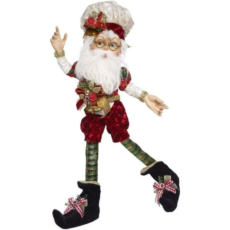 White bearded elf with a red & green Christmas outfit & hat on.