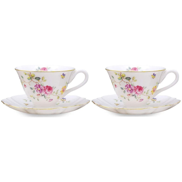 White cup & saucers with pink, yellow & purple flowers & butterflies.