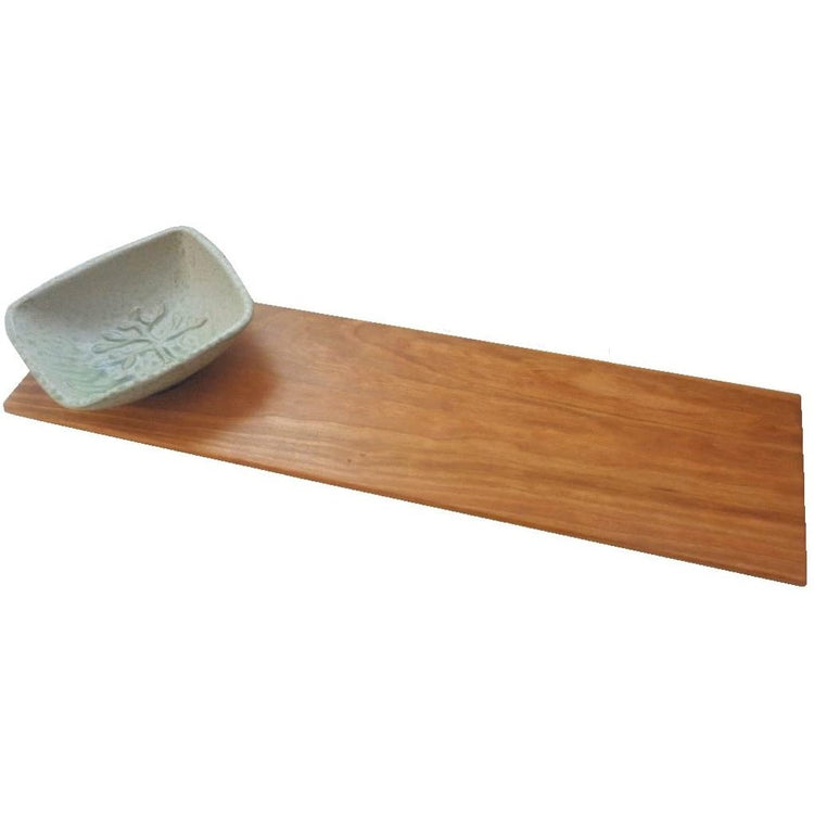 Rectangle shaped wood bread board with pottery rectangle shaped bowl imprinted with a tree.