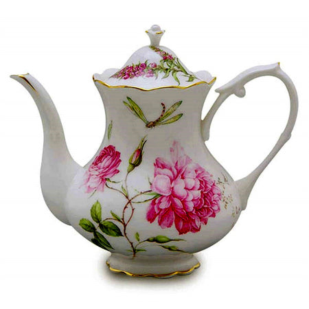 White teapot with pink flowers and a dragonfly.